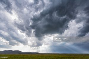 rays-of-light-through-storm-clouds-picture-id1041597210